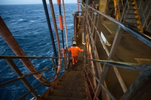 An employee walks down stairs on the Armada gas condensate platform, operated by BG Group Plc, in the North Sea, off the coast of Aberdeen, U.K., on Thursday, Dec. 10, 2015. Royal Dutch Shell Plc got clearance from antitrust authorities in China for the takeover of BG Group Plc, removing the final regulatory hurdle for its biggest-ever deal. Photographer: Simon Dawson/Bloomberg via Getty Images