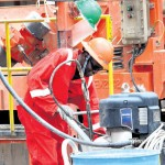 A worker at the Ngamia 1 oil rig in Turkana County